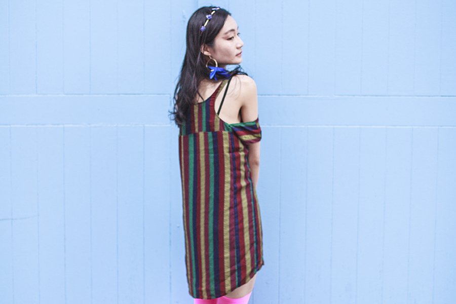 Bohemian Rhapsody Outfit: Urban Outfitters striped off-shoulder dress, We Love Colors neon pink thigh high stockings, paper floral headband from Bangkok, H&M blue feather hoop earrings.