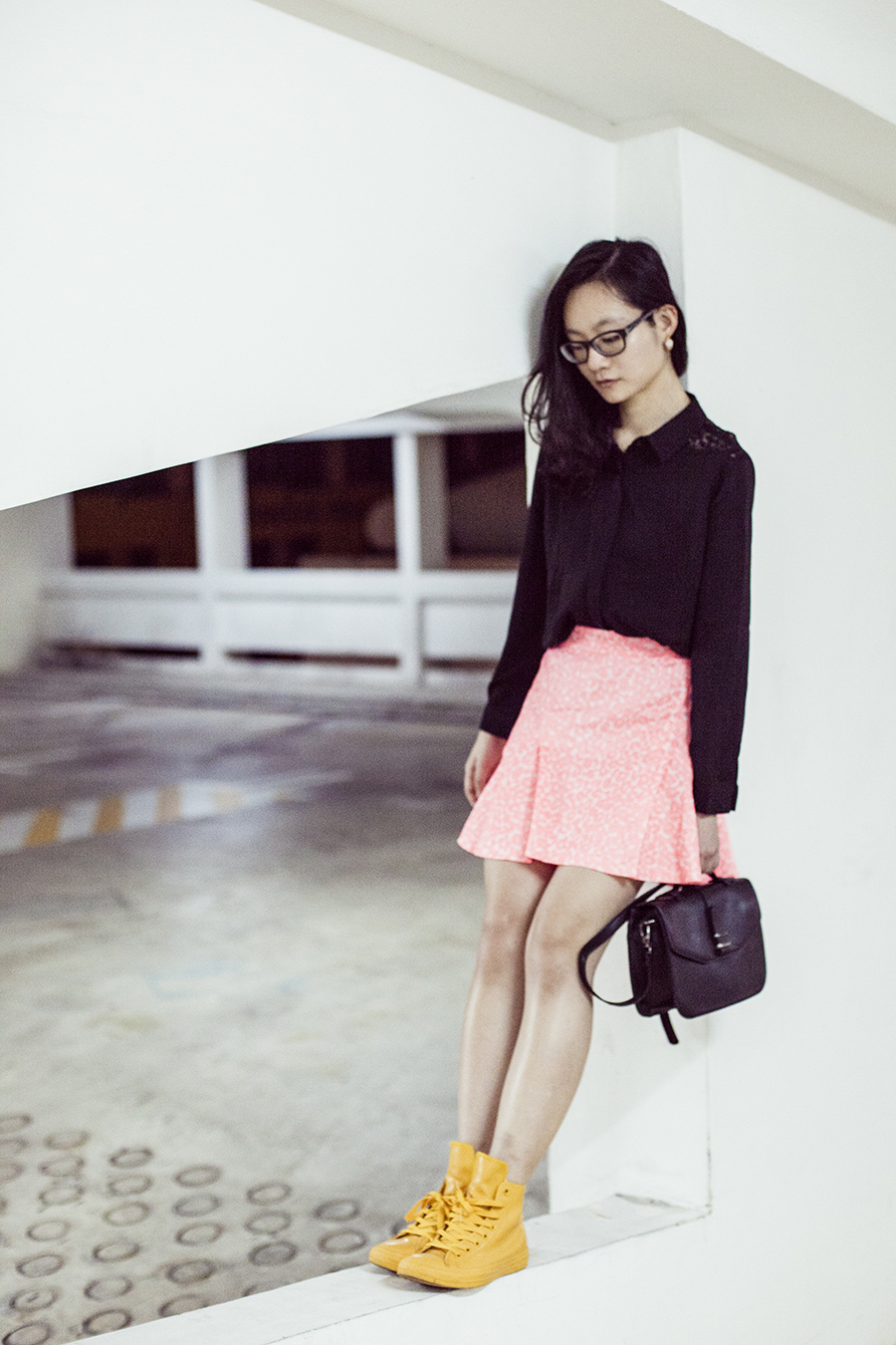 Close-up of Zalora black handbag, Converse yellow rubber sneakers, Juicy Couture neon pink leopard skirt, Zalora black lace shoulder shirt, Gap black rimmed glasses.