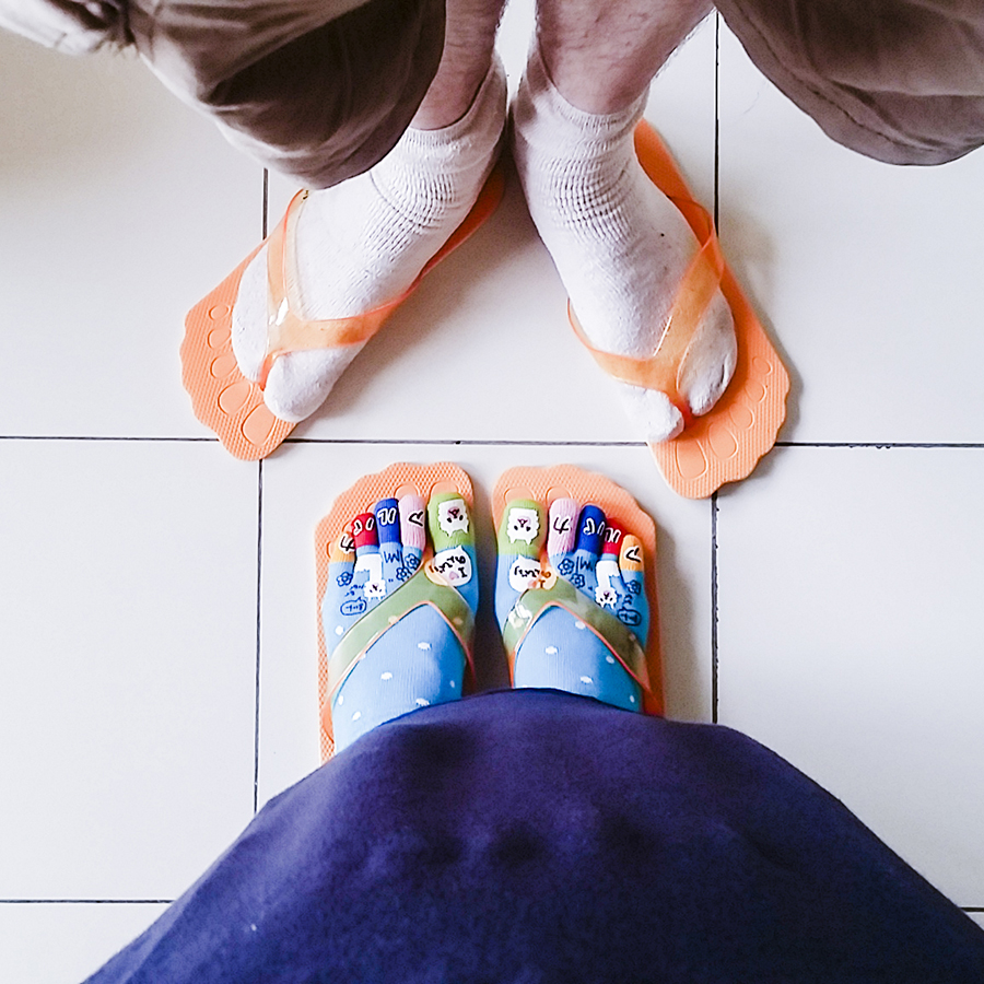 Wearing complimentary orange slippers at Harris Waterfront Resort, Batam, Indonesia.