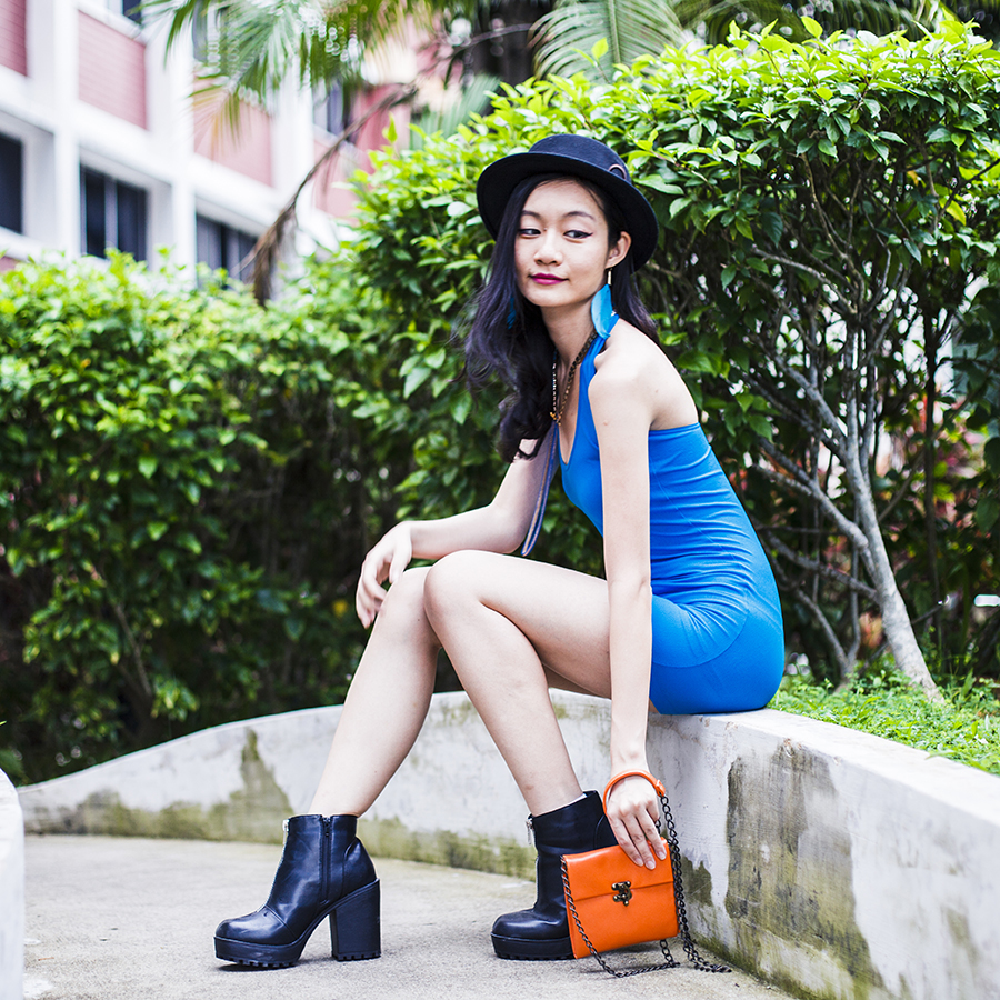 We Love Colors Turquoise Zebra Mini Dress, Forever 21 turquoise feather earrings, Rubi black platform boots, orange shoulder bag from Steve Madden, black Taobao hat.