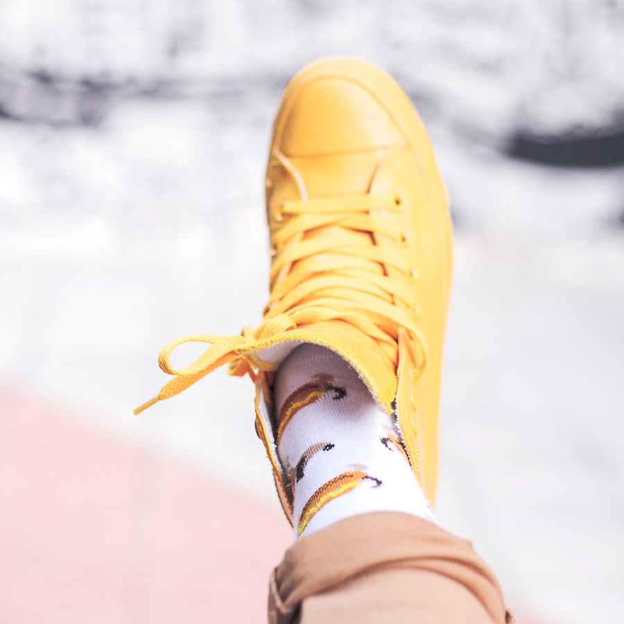 Casual Outfit: Converse yellow rubber all star chuck taylor sneakers, Taobao quirky hotdog socks. Against a Band of Doodlers wall mural in Macpherson.