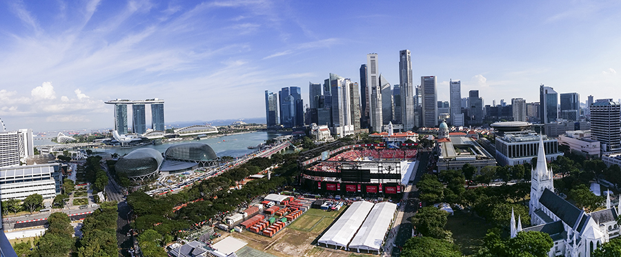 Panoramic view of the downtown central business district of Singapore, Marina Bay Sands, the Padang during National Day Parade rehearsals, the Esplanade, and the Singapore River in the afternoon.