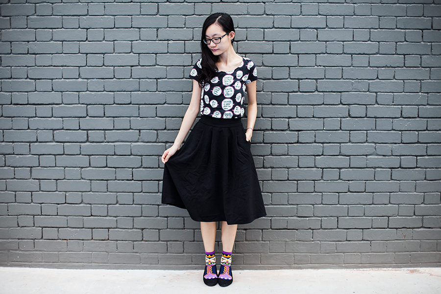 Grey Queen outfit: Uniqlo Jeffrey Fulvimari speech bubbles quirky tee UT, Lowry's Farm black midi skirt with pockets, Vivid Color purple queen socks, Rubi black ballet flats, Gap black frame glasses.