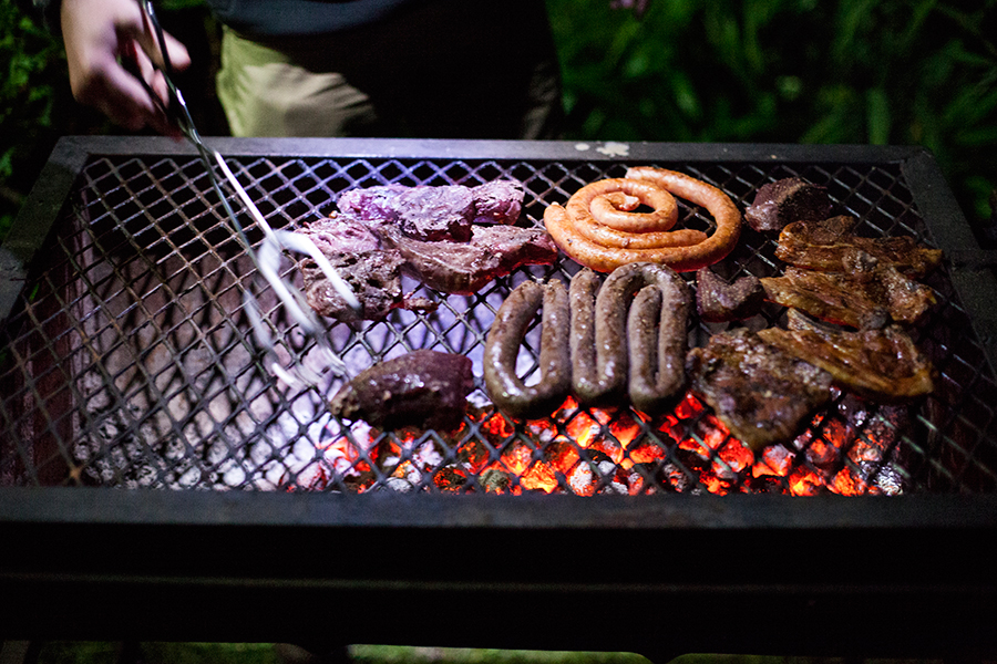 Enjoying a Braai with beef, mutton, and ostrich meat.