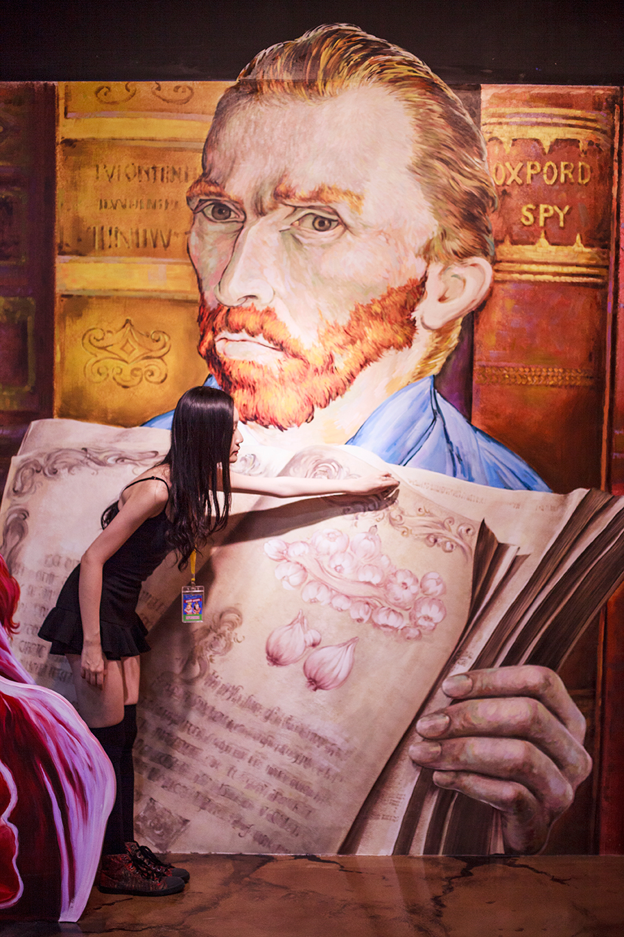 Turning a page of Vincent Van Gogh's book trompe-l'œil at the Trick Eye Museum Renewal Event in Singapore, Resorts World Sentosa.