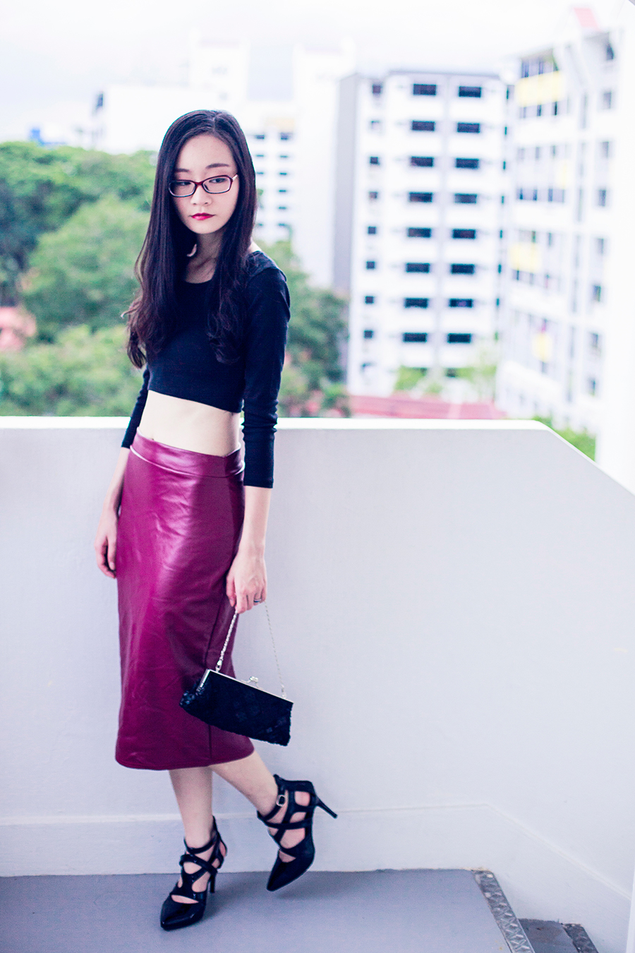 Crop top and midi leatherette skirt. Chomel black sequin purse.
