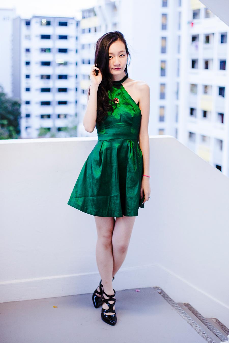 Green satin backless dress from CNDirect, vintage gold rose brooch, Sidewalk patent secret agent heels, Dressin green leaf earrings.