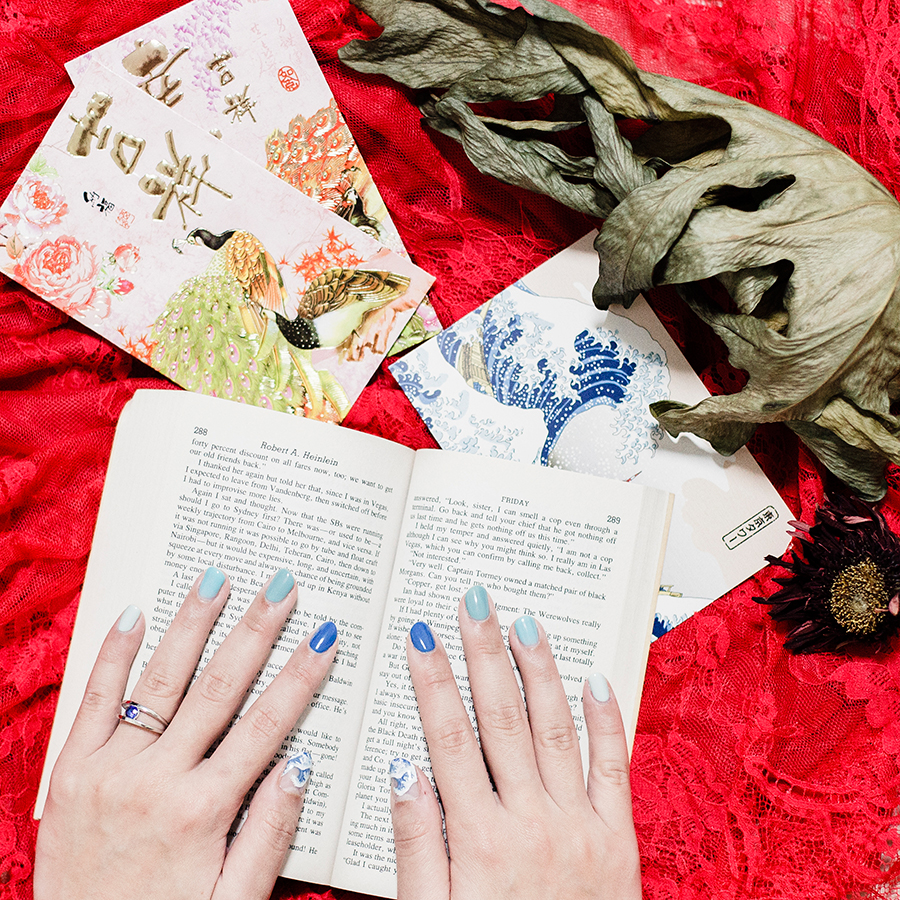 Flatlay blue gel nails by The Nailartasaurus via Vanitee for Chinese New Year.
