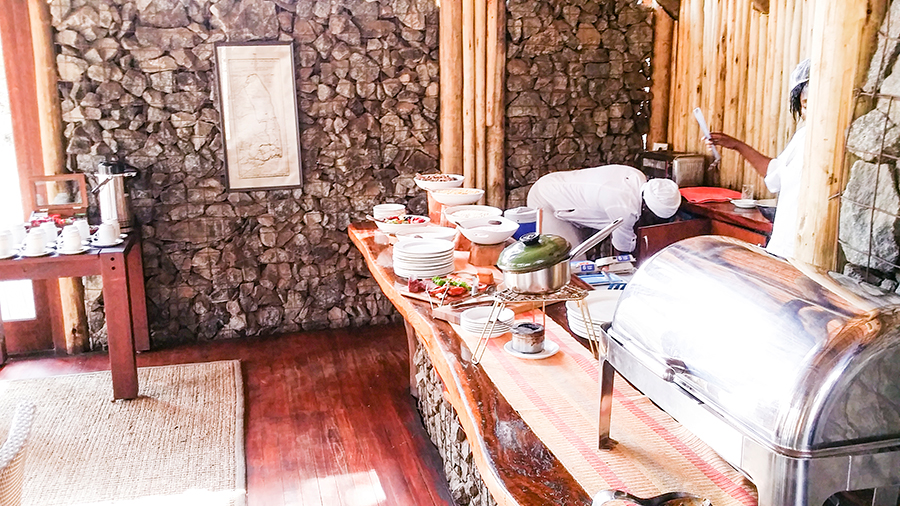 Stone wall and breakfast spread at Rhino Post Safari Lodge, Kruger National Park, South Africa.