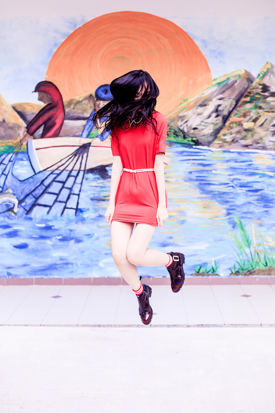 Levitation photo wearing crimson Red tunic dress for Chinese New Year of the Monkey.