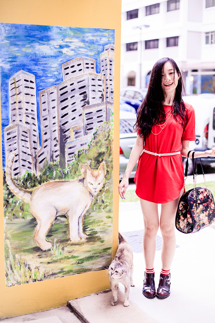 Bonding with the neighbourhood cat for my outfit photo wearing Crimson Red tunic dress for Chinese New Year of the Monkey.