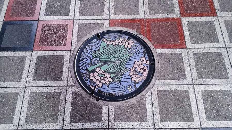 Colourful manhole cover in Osaka, Japan.