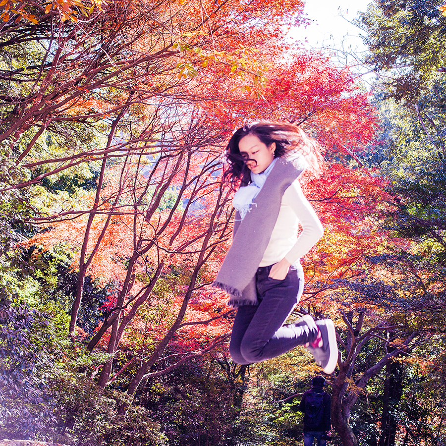 Levitation among autumn leaves at Arashiyama, Kyoto, Japan.