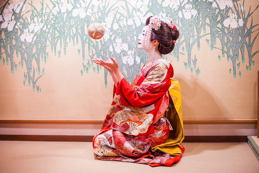 Maiko playing with an ornamental ball at Maica, Gion Kyoto Japan.