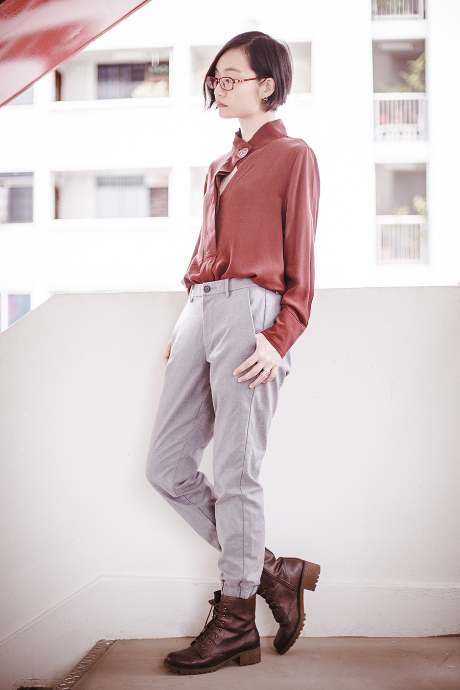 Smart casual ootd: Mango premium silk blouse in rust red, Uniqlo grey jogger pants, Steve Madden brown lace boots, Firmoo red frame glasses, Osewaya triangle ear stud.