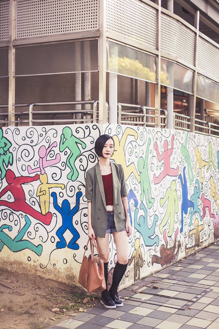 How Do I Look Asia Season 2 premiere party outfit in front of Keith Haring Mural by the Social Creatives Singapore: Topshop blazer, Shein ribbed top, Forever 21 denim shorts, Takashimaya lace knee high socks, Zalora shoes, ARTIKEL constellation necklace, Mango shopper tote bag.
