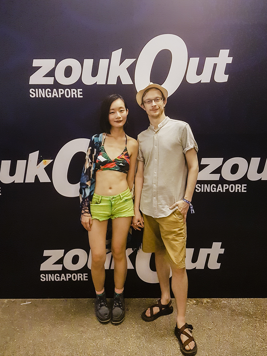 ZoukOut 2016 outfit: Missguided Parrot Print Crossover Bikini Top, Forever 21 green denim shorts, CNDirect blue chiffon kimono cardigan, Topman gorilla socks, Timberland blue boots. Thisguyah wears Zalora shirt, Cotton On shorts, straw hat, sandals.