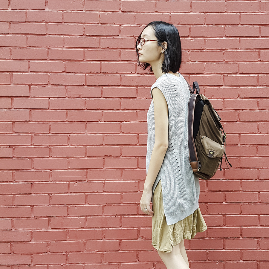 Neutral Minimalist Style: Uniqlo oversized knit vest, Zara skirt, Fossil backpack, Firmoo red glasses, Cirkus Charms silver triangle earrings.