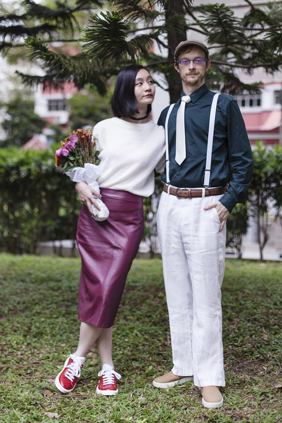 Christmas Couple Outfits: She's wearing - GU sweater, Dresslily christmas tree lace choker, CNDirect PU skirt, BeetleBug red sneakers, handmade flower bouquet. He's wearing - Mango green dress shirt, 2nd Edition flat cap, Timberland loafers,