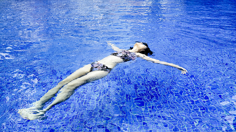 Floating in a swimming pool wearing Funfit floral bikini.