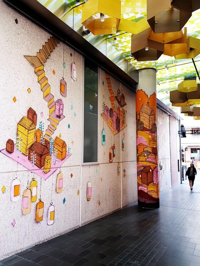 Orange murals in The Mitchell's Building Facade in Perth Australia.