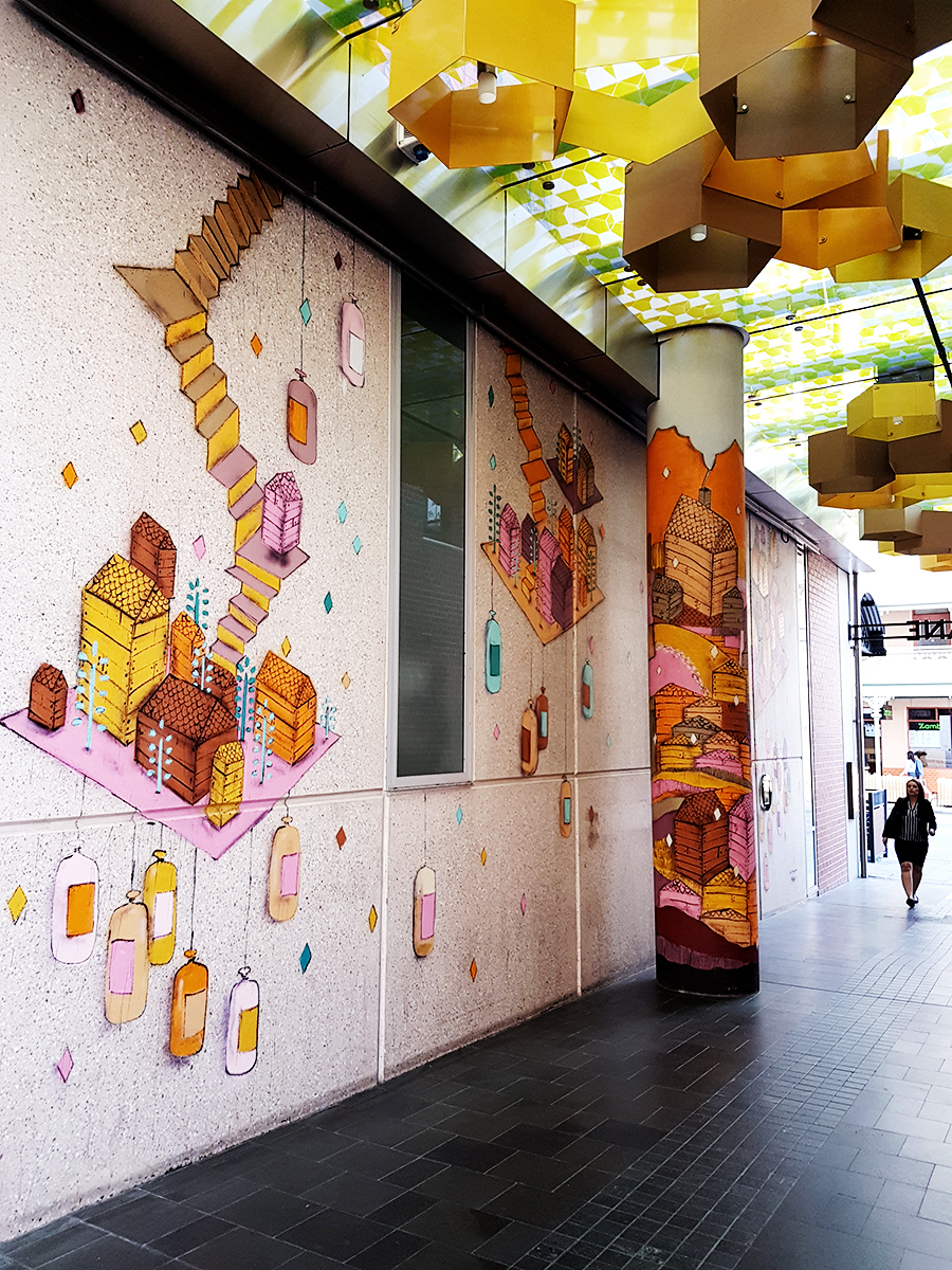 Orange murals in The Mitchell's Building Facade in Perth Australia.