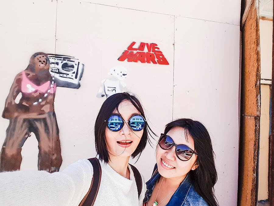 Selfie in front of Love Wars grafitti in Fremantle Perth Australia.