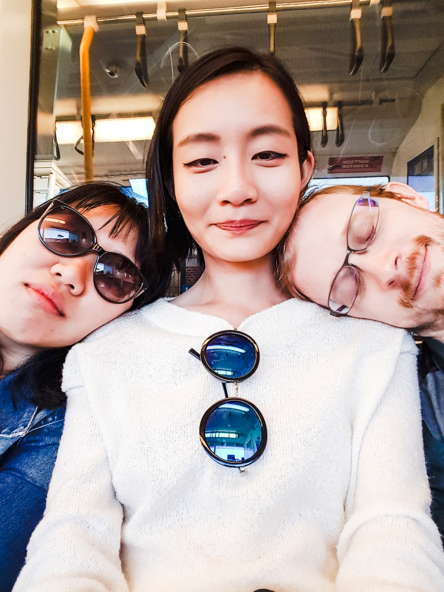 Selfie with two tired friends resting their heads on my shoulders.