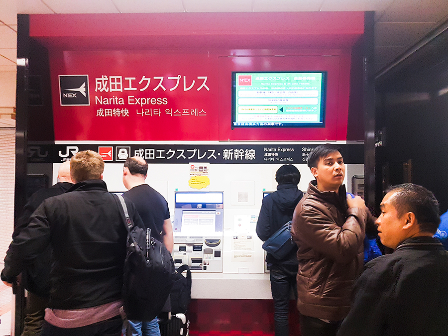 Buying a Narita Express ticket at the automated machines at Narita Train station.