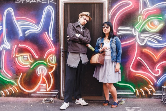 Ottie and Kooling posing in front of a neon lights mural in Perth Australia.