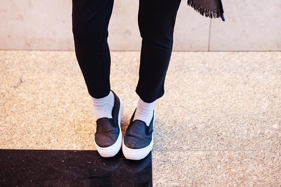 Black monochrome outfit for traveling: WholeSaleBuying black harem pants, Spurr shoes.