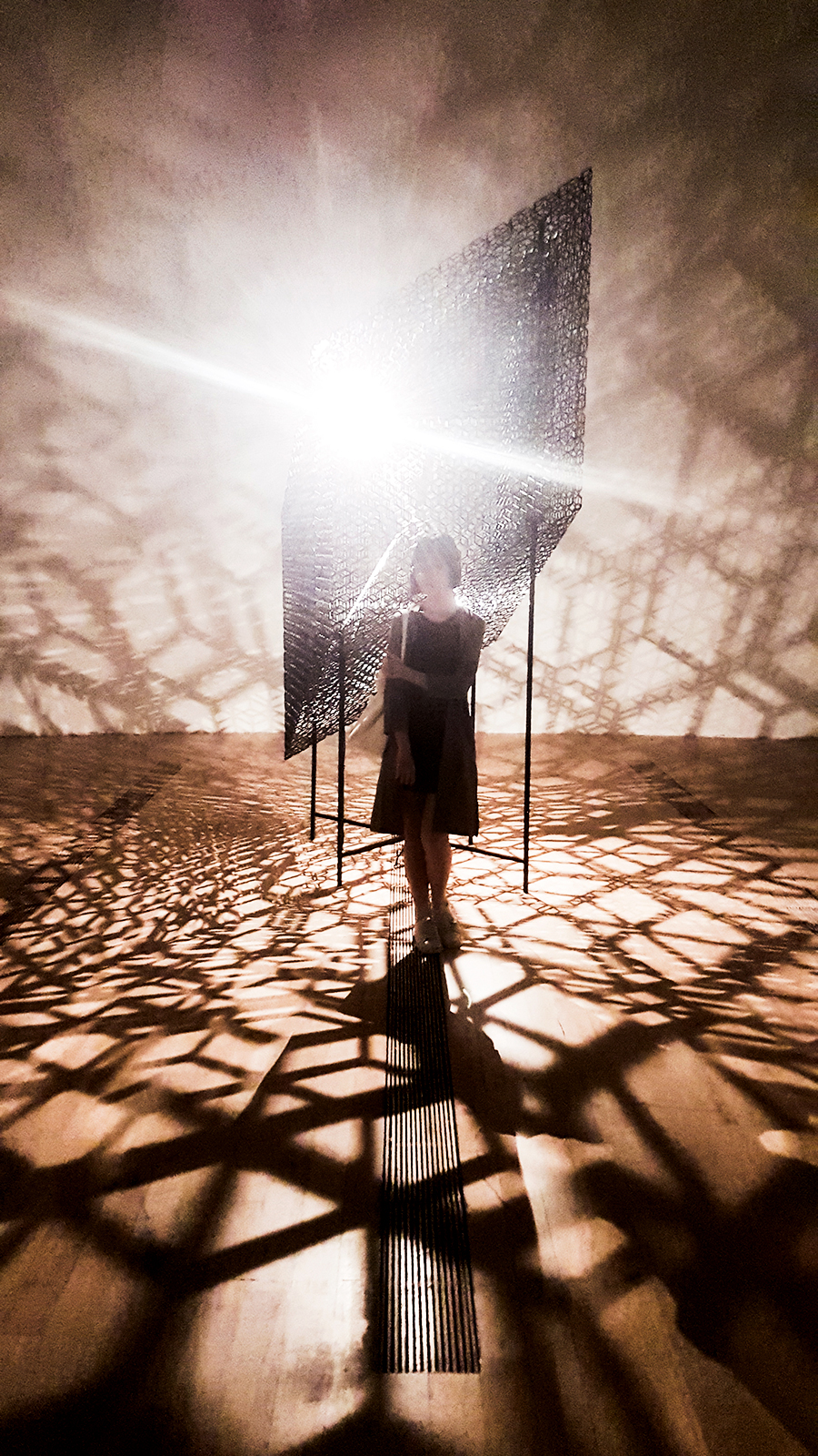 Light and shadow room at the The Universe and Art: An Artistic Voyage Through Space exhibition, ArtScience Museum Singapore.