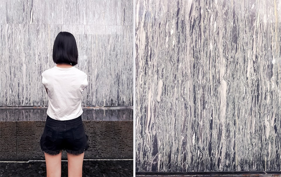 Taking a photo of a textured wall at Parkroyal at Pickering, Singapore.