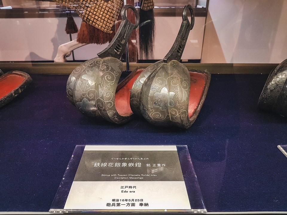 Yasukuni Shrine Museum: Stirrup with Tessen (Clematis Florida) Inlay, Inscription Masashige.