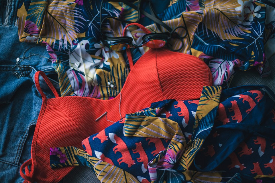 Zaful swim wrap kimono flatlay, Billabong Love Myself Bralette Bikini Top, Aldo Cocia Necklace, CNDirect distressed denim shorts.