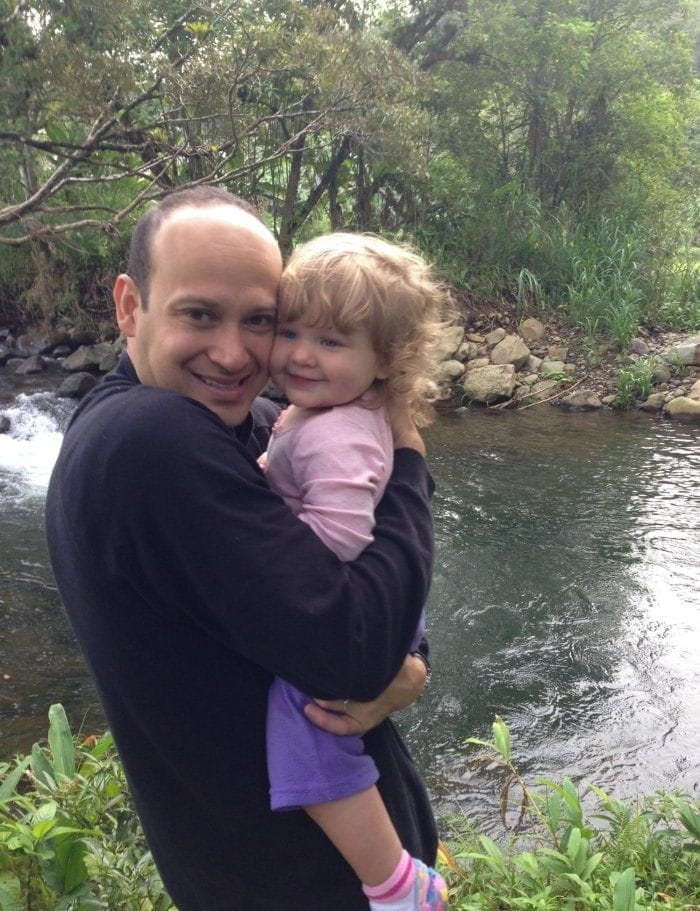 Daddy and baby enjoying time by the river in the Costa Rica rainforest. We have NEVER regretted taking our girls on vacation to Costa Rica!