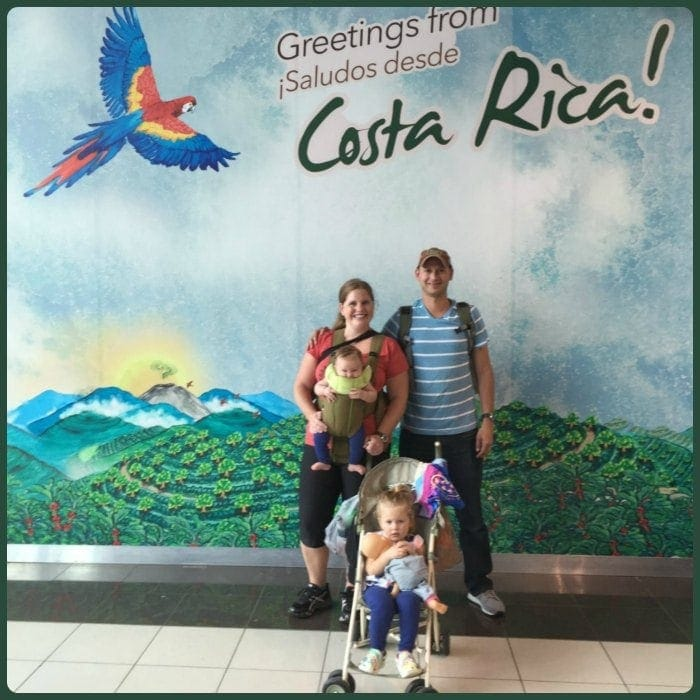The whole family, bright and early at the San José Airport, about to optimistically embark on our journey home.