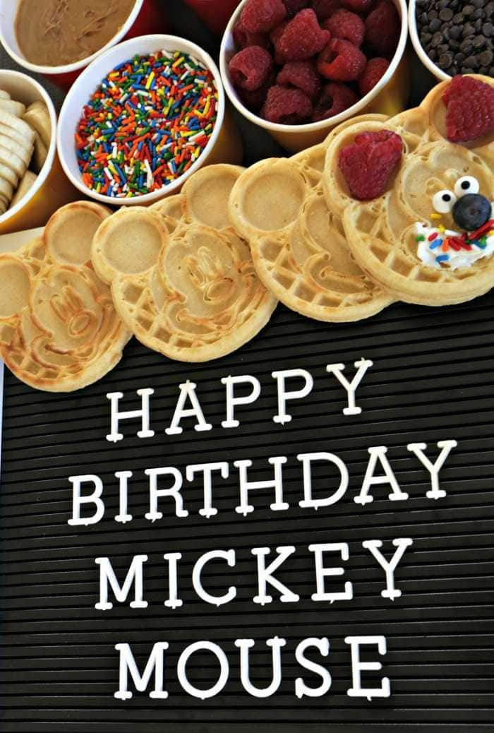This easy breakfast waffle bar idea is the perfect fun and simple way to celebrate Mickey Mouse's 90th birthday- and includes a topping everyone will love!!