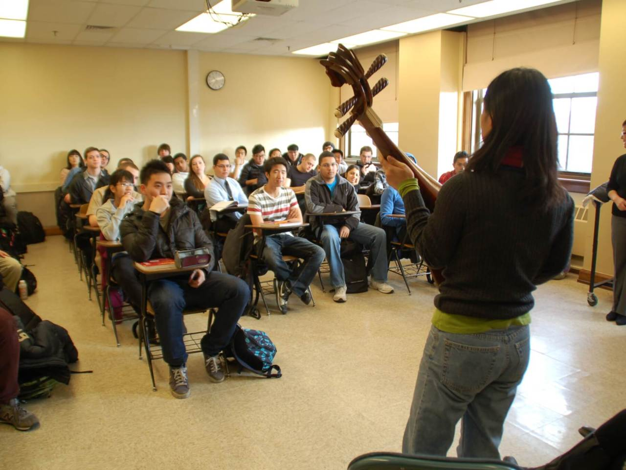 Wu Man gives a Purdue class a demonstration of the pipa