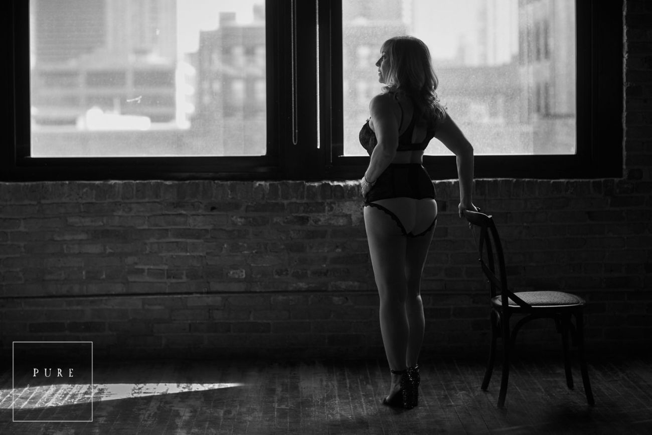 middle age woman and boudoir session with black and white