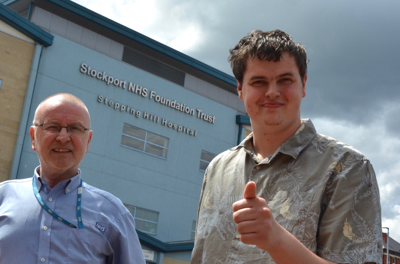 Intern Alex outdie Stepping Hill Hospital with his mentor