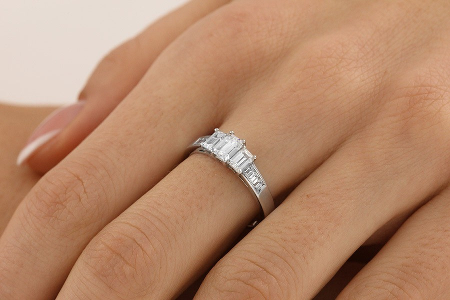 Emerald Cut Three Stone Diamond Ring With Shoulders In