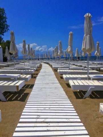 Platanias white umbrellas