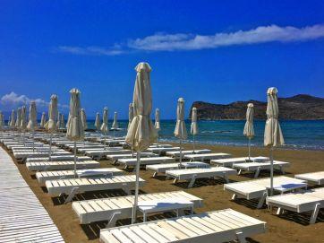 platanias white umbrellas and blue sea
