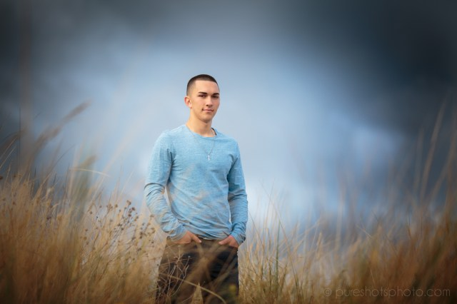 Standing tall in front of the storm, senior photos at Mukilteo Beach