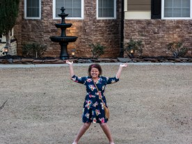 Ella lifting the house