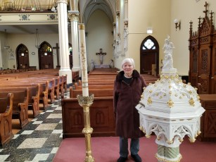 Mom next to her baptismal