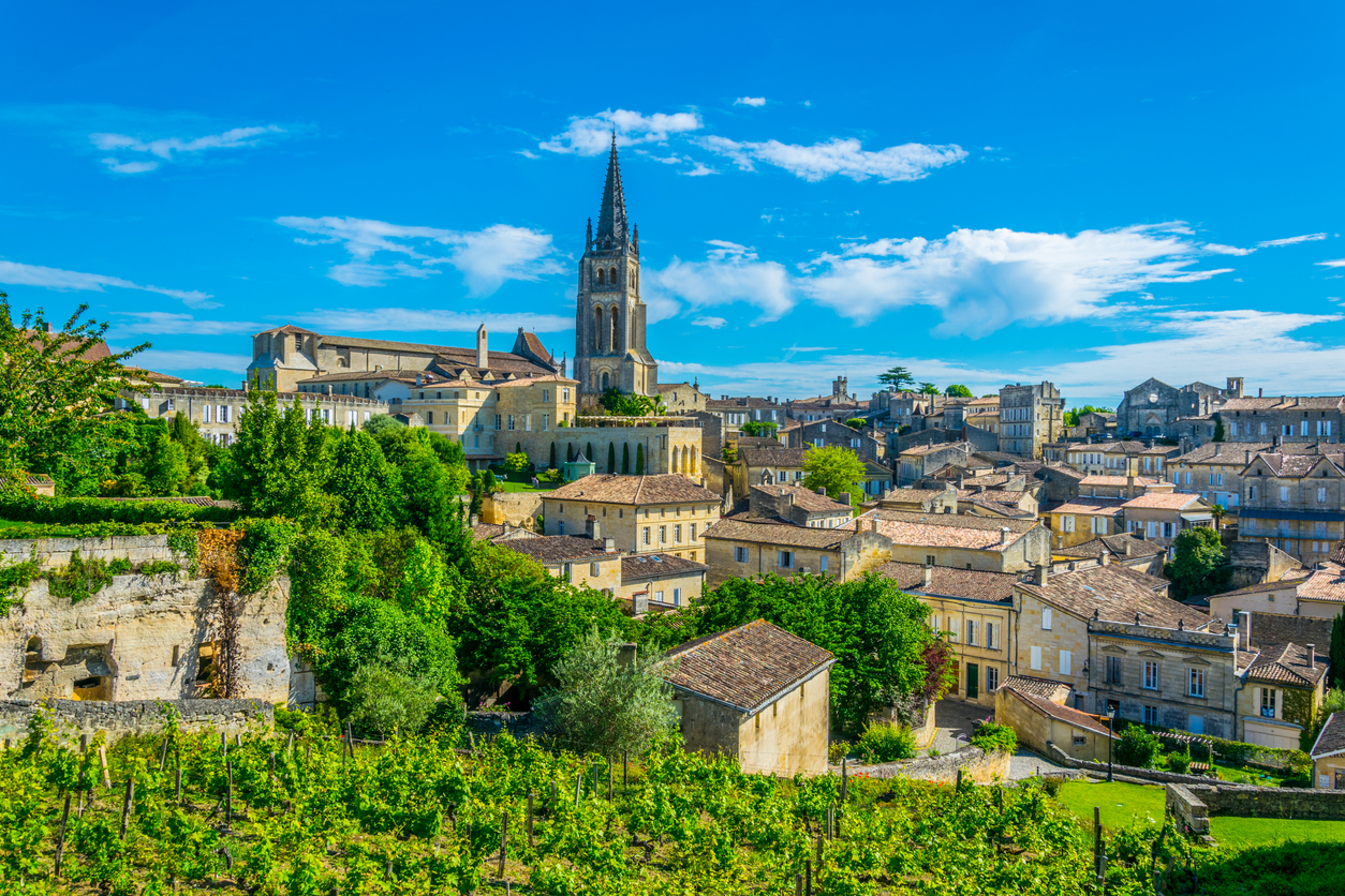 Aerial view of French village Saint Emilion dominated by spire of the monolithic church