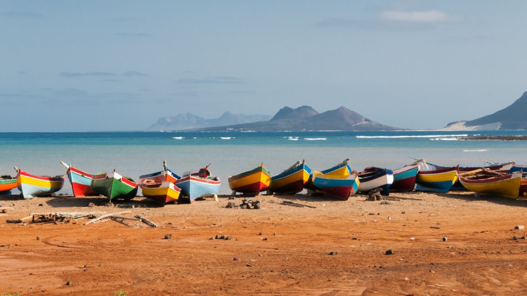 Fishing boats rest in Mindelo beach, Cape Verde.