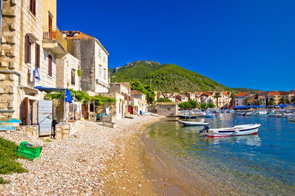 Komiiza city beach and ancient architecture, Vis island, Croatia